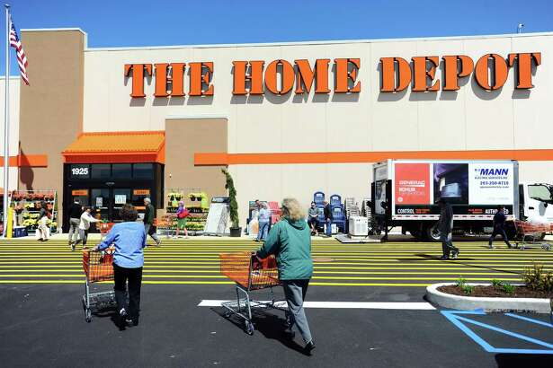Shoppers walk into the new Home Depot store at 1925 W. Main St., on the west side of Stamford, Conn., on its opening day on Thursday, April 26, 2018.