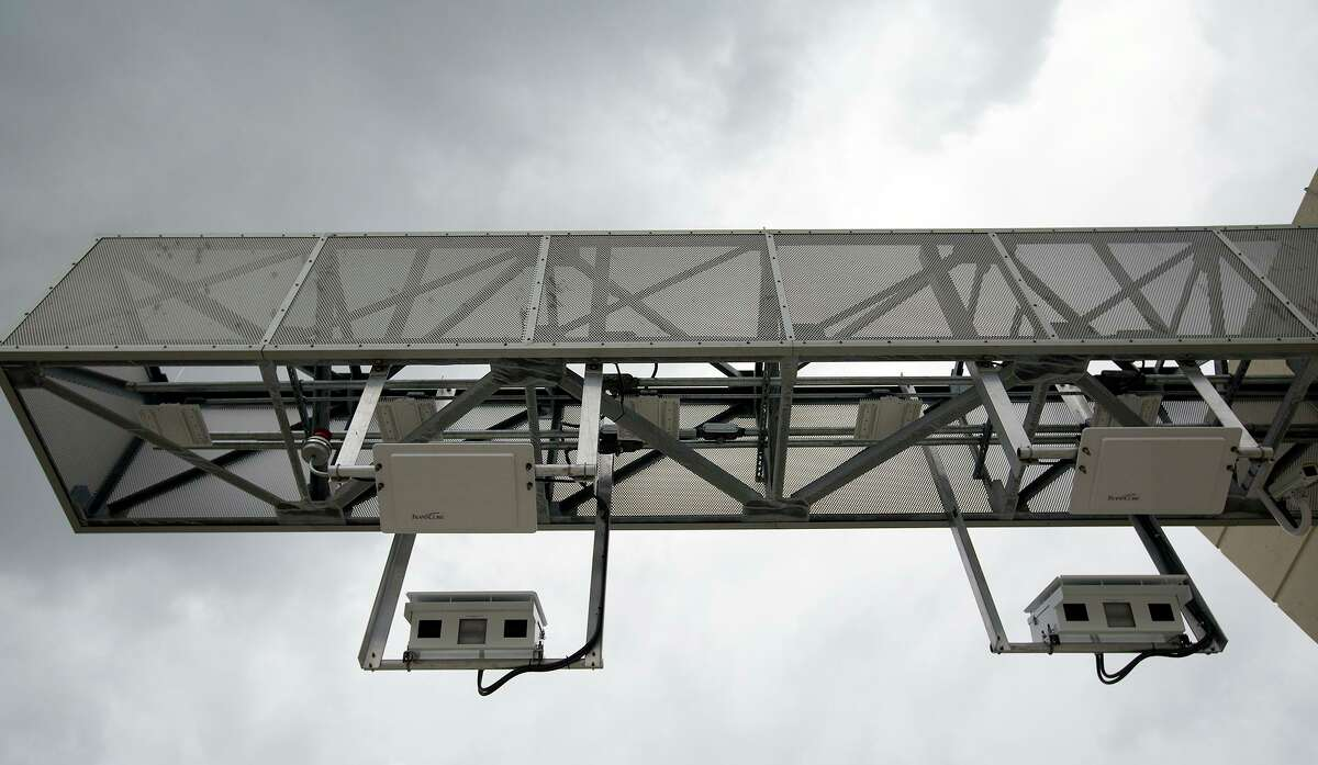 Toll tag cameras are seen along the Sam Houston Tollway entrance ramp from Texas 249 on Oct. 30, 2015, in Houston.