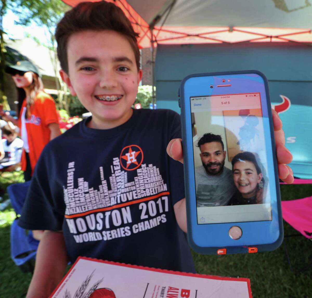 Will Hayes was able to get a photo with Houston Astros Jose Altuve after Houston Texans J.J. Watt and Altuve delivered a brand new Papa John's Pizza decorated truck to his father, Donald Hayes Thursday, April 26, 2018, in Pearland. Hayes won the truck through a Papa John's Pizza contest.