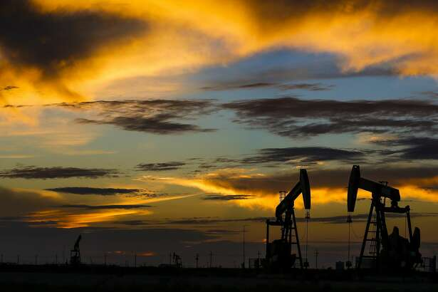 Pumpjacks sit over land leased by Diamondback Energy for horizontal drilling Wednesday, Sept. 14, 2016 outside Midland. ( Michael Ciaglo / Houston Chronicle )
