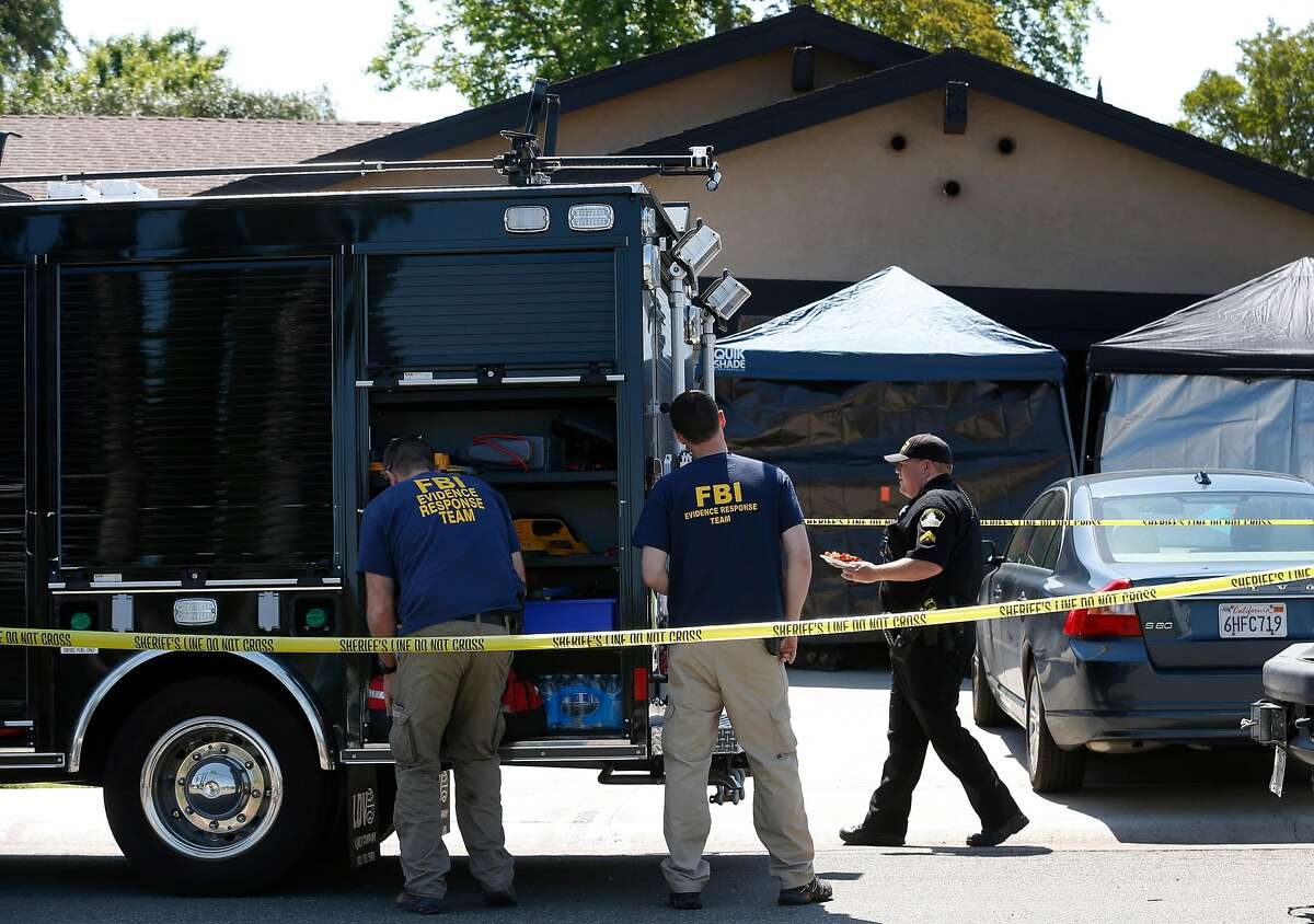 An FBI forensics team collects evidence from the home of Joseph DeAngelo in Citrus Heights on April 26, 2018.