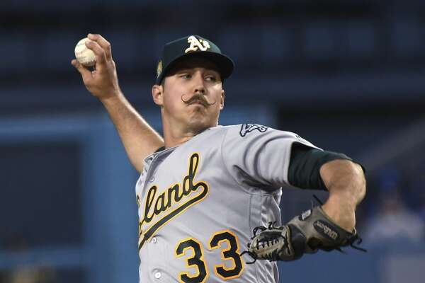 Oakland Athletics pitcher Daniel Mengden throws during the first inning of the team's baseball game against the Los Angeles Dodgers, Wednesday, April 11, 2018, in Los Angeles. (AP Photo/Michael Owen Baker)
