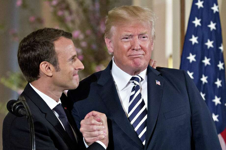 President Donald Trump, right, shakes hands with Emmanuel Macron, France's president, at a news conference in the East Room of the White House during a state on Tuesday. Photo: Andrew Harrer / Bloomberg / © 2018 Bloomberg Finance LP