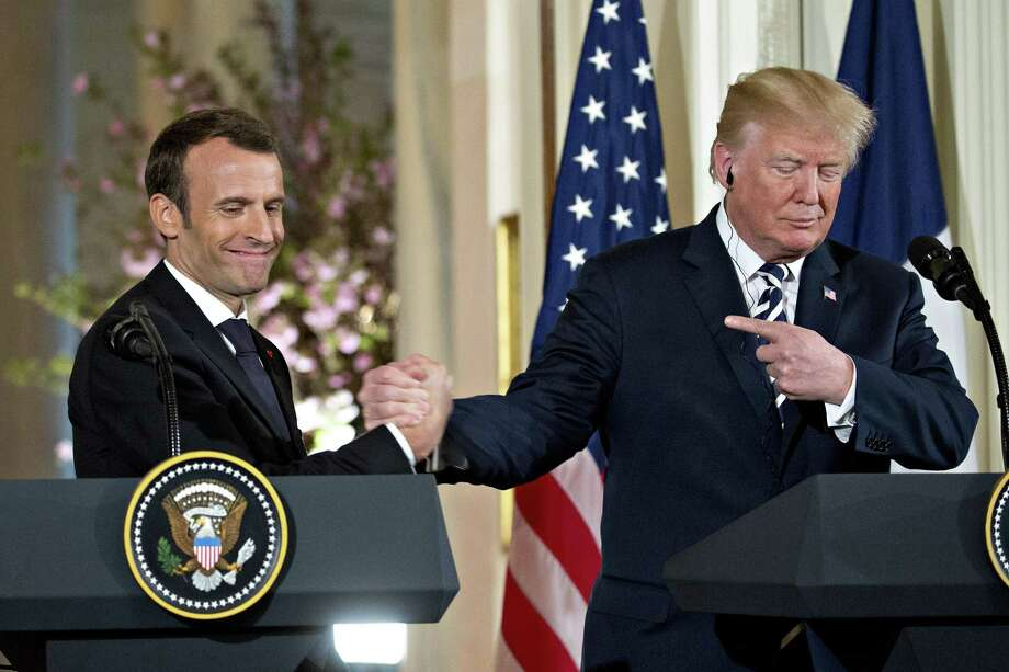 President Donald Trump, right, points to Emmanuel Macron, France's president, at a news conference during a state visit in the East Room of the White House on Tuesday. Photo: Andrew Harrer / Bloomberg / © 2018 Bloomberg Finance LP