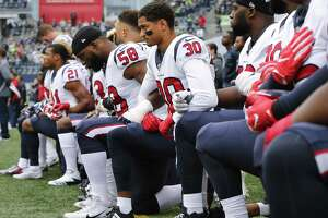 Members of the Houston Texans kneel during the national anthem before the game at CenturyLink Field on Oct. 29, 2017 in Seattle, Washington.