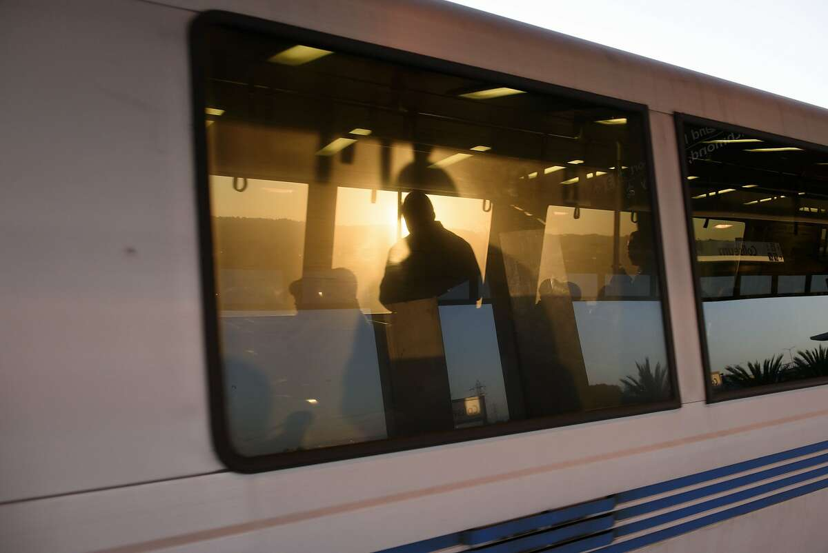 Passengers are silhouetted by the morning sun on the BART train ridden by Qudratullah Afshar as heads to his job at the Bohemian Club in San Francisco, from his home in San Leandro, CA, on Thursday April 19, 2018.