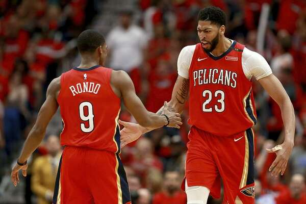 NEW ORLEANS, LA - APRIL 19:  Rajon Rondo #9 of the New Orleans Pelicans and Anthony Davis #23 of the New Orleans Pelicans react after scoring during Game 3 of the Western Conference playoffs against the Portland Trail Blazers at the Smoothie King Center on April 19, 2018 in New Orleans, Louisiana. NOTE TO USER: User expressly acknowledges and agrees that, by downloading and or using this photograph, User is consenting to the terms and conditions of the Getty Images License Agreement.  (Photo by Sean Gardner/Getty Images)