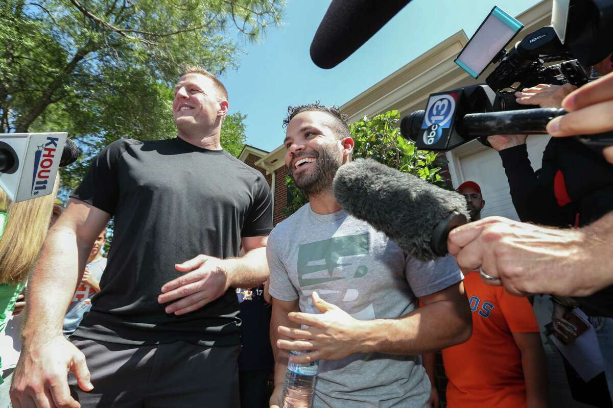 Houston Texans J.J. Watt and Houston Astros Jose Altuve delivered a brand new Papa John's Pizza decorated truck to Donald Hayes Thursday, April 26, 2018, in Pearland. Hayes won the truck through a Papa John's Pizza contest.