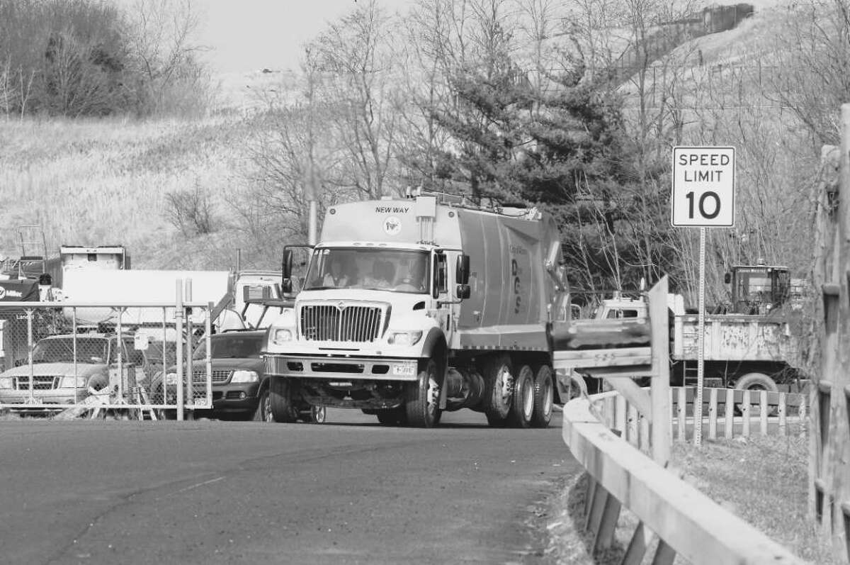 A city of Albany DGS truck exits the main entrance of the City of Albany Waste Management Facility on Rapp Road. (James Goolsby /Times Union )