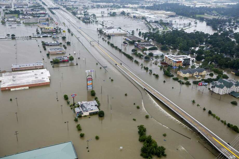 Floodwaters from Tropical Storm Harvey cover I-69 on Tuesday, Aug. 29, 2017, in Humble. ( Brett Coomer / Houston Chronicle ) Photo: Brett Coomer, Staff / Houston Chronicle / © 2017 Houston Chronicle