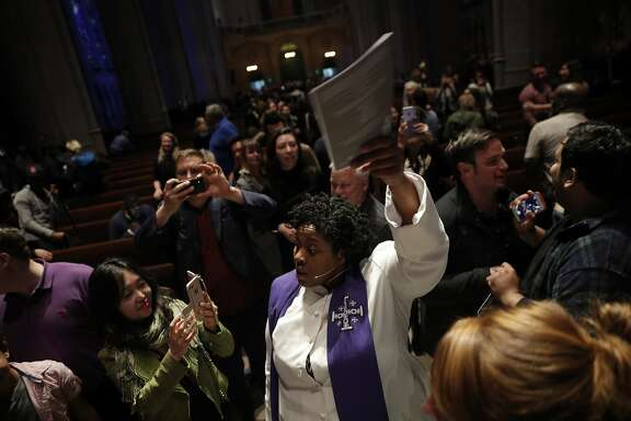 The Rev. Yolanda Norton (center), of the San Francisco Theological Seminary, dances with congregants at Grace Cathedral to celebrate the Beyonce Mass on Wednesday, April 25, 2017 in San Francisco, Calif.