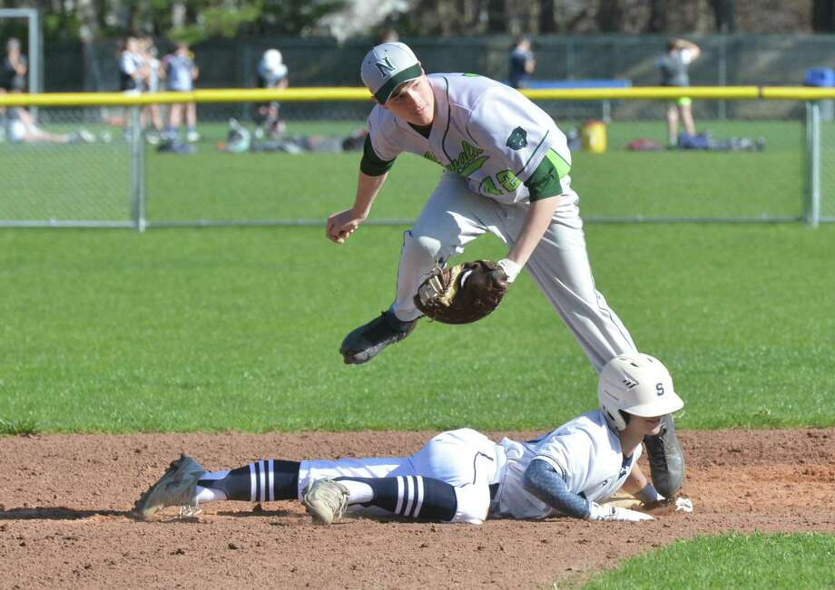 Norwalk's #42 Scott Whalen makes the tag on Staples High School's # 6  Renato Llamas in baseball action on Thursday April 26, 2018 in Westport Conn. Photo: Alex Von Kleydorff / Hearst Connecticut Media / Norwalk Hour