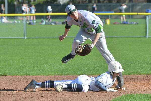 Norwalk's #42 Scott Whalen makes the tag on Staples High School's # 6  Renato Llamas in baseball action on Thursday April 26, 2018 in Westport Conn.
