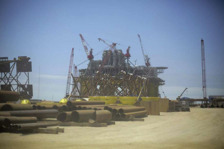 The view of Appomattox, Shell's new Gulf deepwater platform, from a dusty van window as a tour makes its way to the platform before it's set out to sea on Monday, April 23, 2018, in Ingleside, Texas. ( Elizabeth Conley / Houston Chronicle ) Photo: Elizabeth Conley, Chronicle / Houston Chronicle / © 2018 Houston Chronicle
