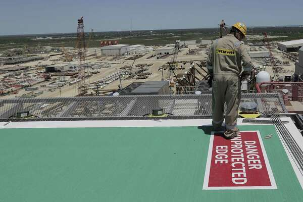 A Kiewit employee checks out the corner of the helipad on Shell's new Gulf deepwater platform, Appomattox, before it's set out to sea on Monday, April 23, 2018, in Ingleside, Texas. The helipcopter is the most common way to switch crews once the platform is in place in the Gulf of Mexico. ( Elizabeth Conley / Houston Chronicle )