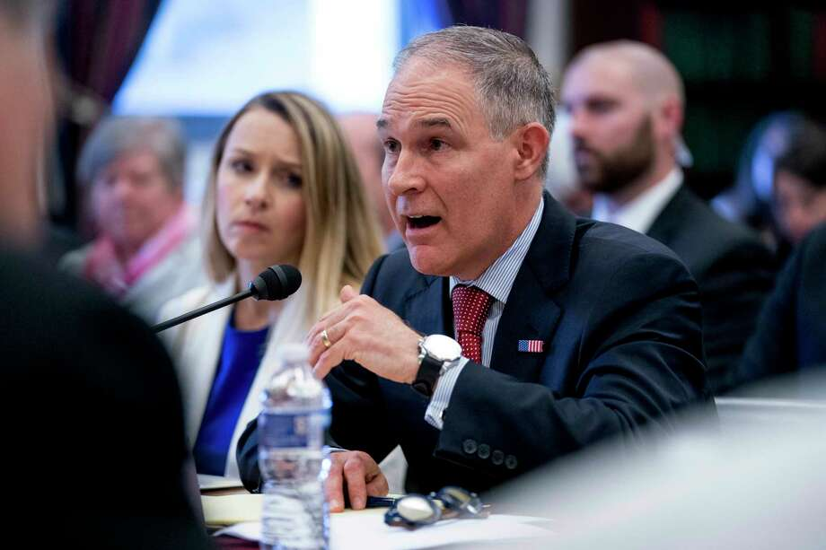Environmental Protection Agency Administrator Scott Pruitt, accompanied by accompanied by Environmental Protection Agency Chief Financial Officer Holly Greaves, left, testifies on the EPA FY2019 budget at a House Appropriations Subcommittee on Interior, Environment and Related Agencies on Capitol Hill in Washington, Thursday, April 26, 2018. (AP Photo/Andrew Harnik) Photo: Andrew Harnik / Copyright 2018 The Associated Press. All rights reserved.