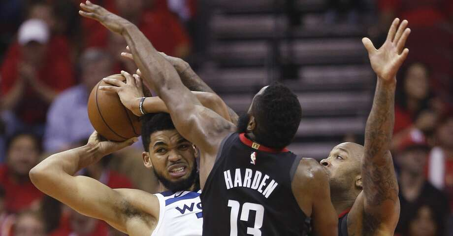 Minnesota Timberwolves center Karl-Anthony Towns (32) is cornered by Houston Rockets guard James Harden (13) and forward PJ Tucker during the first half of Game 5 of an NBA basketball first-round playoff series Wednesday, April 25, 2018, in Houston. (Brett Coomer/Houston Chronicle via AP) Photo: Brett Coomer/Associated Press