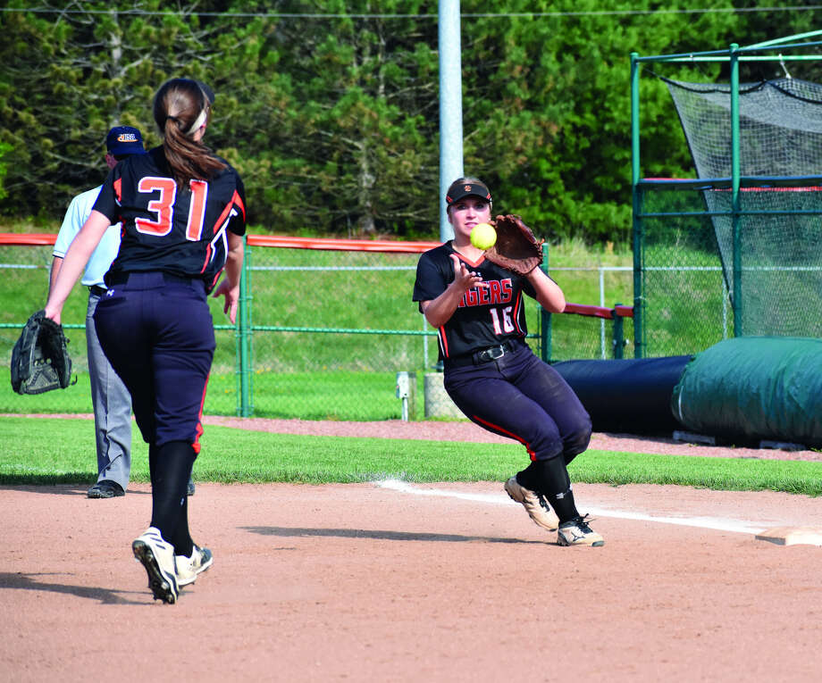EHS first baseman Mackenzie Owens, left, flips a throw to second baseman Emma Lewis to record an out at first against Granite City on Thursday.