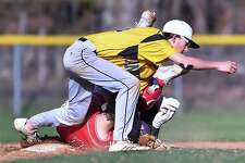 Prep senior Phillip Dejesus steals second on Amity second baseman Christopher Parkin Thursday, April 26, 2018, at Field at Janenda Field at Amity High School in Woodbridge. The Jesuits won, 1-0.