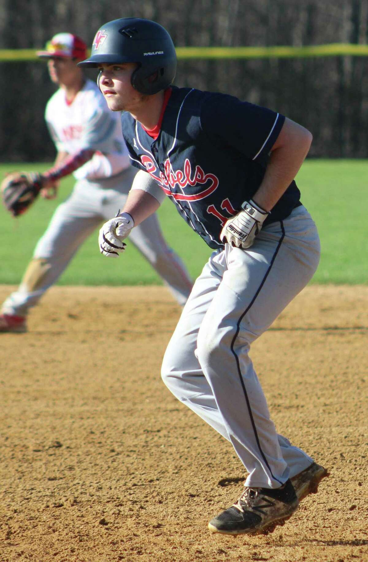 New Fairfield's Chris Forsberg takes his secondary lead off first base during the baseball game against Masuk at New Fairfield High School April 26, 2018.