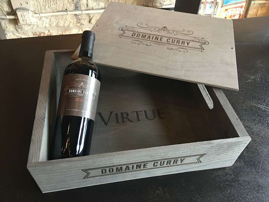 "Four-packs of Domaine Curry wines come in decorative boxes. The ""virtue"" inscribed in the box is a reference to Proverbs 31, a Bible passage that describes a virtuous woman. The wine's name, Femme 31, was inspired by the chapter. Photo: Naomi Filipelli"