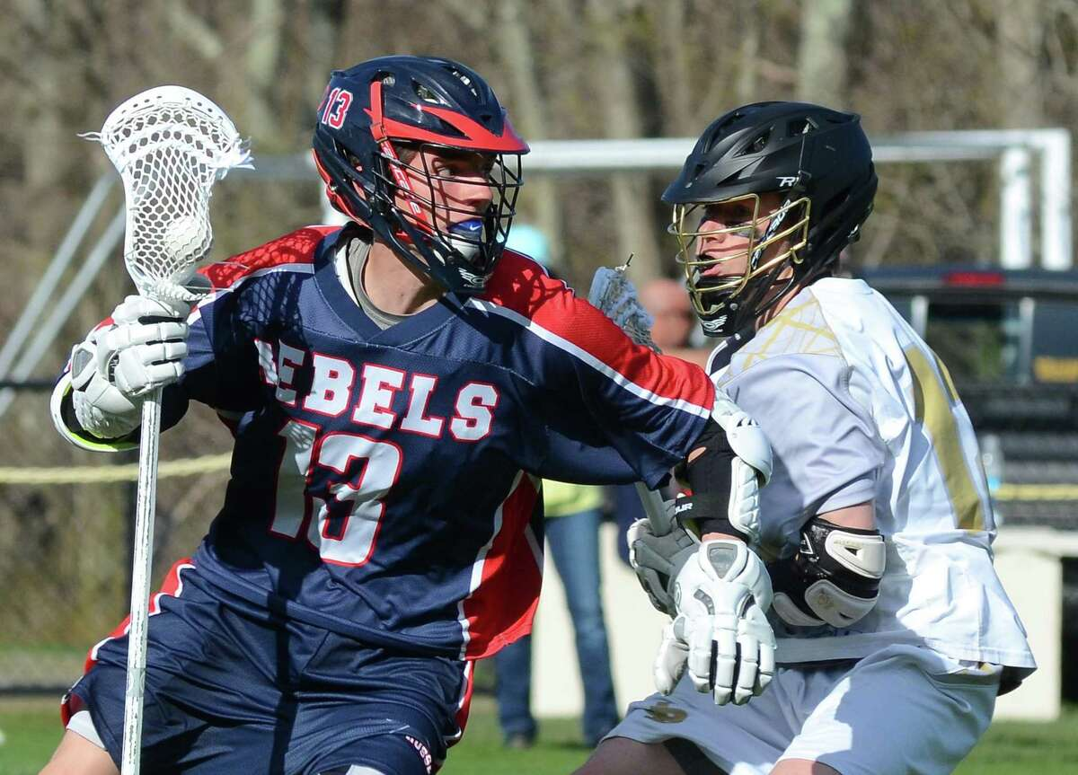 New Fairfield's Nicholas Gephart (13) drives the ball behind the goal as Joel Barlow's Grant LaGaipa defends during boys lacrosse action in Redding, Conn., on Thursday Apr. 26, 2018.