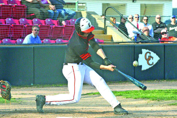 Edwardsville senior Reid Hendrickson delivers an RBI double during the fourth inning of Thursday's Southwestern Conference game at Granite City.