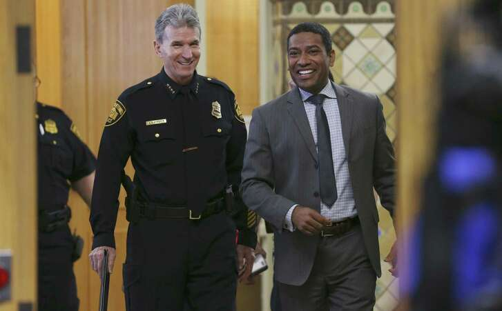 San Antonio Police Chief William McManus, left, walks in with City Council District 2 member William ÒCruzÓ Shaw for a press conference presenting results of an independent review of cases handled by the SAPD Special Victims Unit, Thursday, April 26, 2018. Last year in November, Special Victims Unit Detective Kenneth Valdez was fired for mishandling more than 130 sex and family cases.