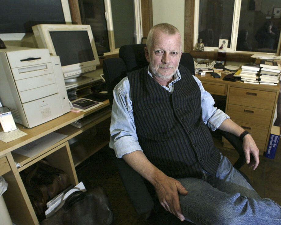 Sam Hamill, editor of the prestigious Copper Caynon Press, sits in his home office, Thursday, Jan. 30, 2003, in Port Townsend, Wash. The White House Symposium on Poetry and the American Voice was cancelled Wednesday after it was believed the event would be politicized. Hamill e-mailed friends asking for poems or statements opposing military action against Iraq. He had expected about 50 responses; hes gotten about 2,000, including contributions from W.S. Merwin, Adrienne Rich and Lawrence Ferlinghetti.(AP photo/Jim Bryant) Photo: JIM BRYANT / AP