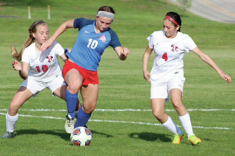 Carlinville's Lexi Egelhoff, center, controls the ball against Roxana's Olivia Mouser, left, and Alyssa Mendoza in action Thursday at the Wood River Soccer Park. Egelhoff had an assist on Makalya Procter's first-half goal, but Roxana beat the Cavies 2-1 in double overtime. Photo:     Pete Hayes | The Telegraph