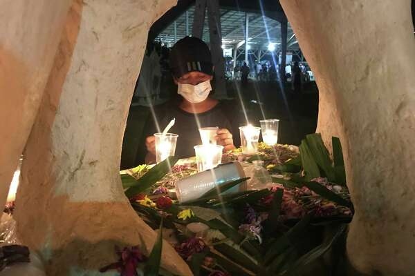 Inside the Polytechnic University of Nicaragua in Managua, which has become a stronghold for protesters, a woman lights candles at a makeshift memorial for students who have been killed in recent unrest.