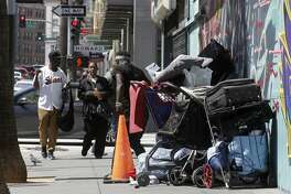 A small homeless encampment camp near the corner of 6th and Howard streets on Mon. April 23, 2018, in San Francisco, Calif. San Francisco City Hall politicians continue to struggle with a fix for the real public health menace on our sidewalks the dirty needles, tent encampments, feces and foul garbage.