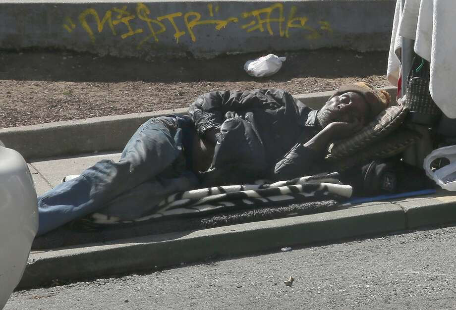A man sleeping on Natoma Street on Friday, April 20, 2018, in San Francisco, Calif.  City Hall has taken decisive action on scooters plaguing SOMA sidewalks, but has taken little action on homeless, drug use, and feces woes such as this man. Photo: Liz Hafalia, The Chronicle