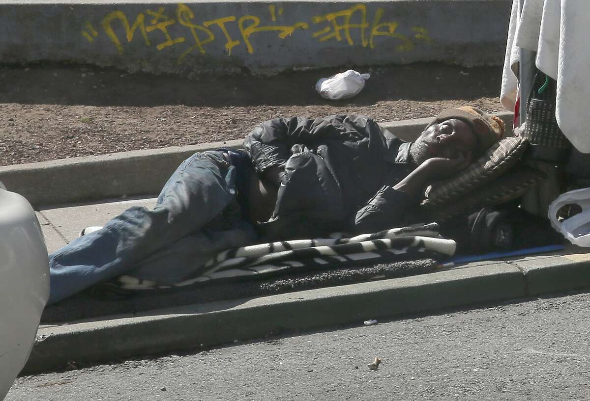 A man sleeping on Natoma Street on Friday, April 20, 2018, in San Francisco, Calif. City Hall has taken decisive action on scooters plaguing SOMA sidewalks, but has taken little action on homeless, drug use, and feces woes such as this man.