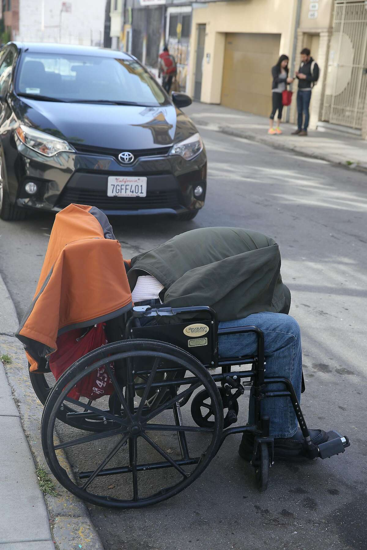 A man sleeping in his wheel chair on Natoma St. on Friday, April 20, 2018, in San Francisco, Calif. City Hall has taken decisive action on scooters plaguing SOMA sidewalks, but has taken little action on homeless, drug use, and feces woes such as this man.