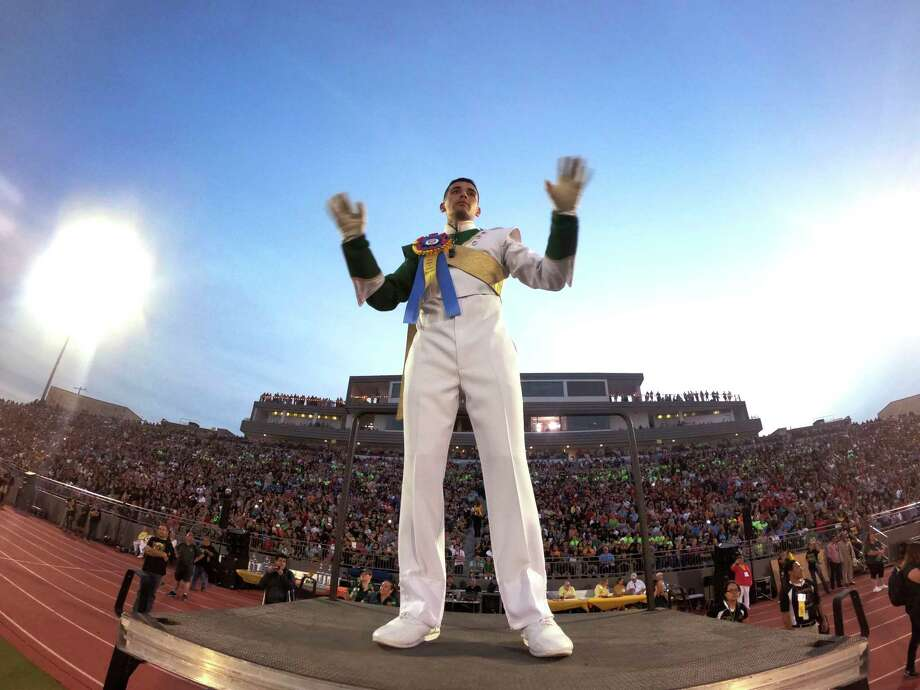 Eric Martinez, drum major of the McCollum band, directs during the Battle of Flowers Association's annual band festival at Alamo Stadium on Thursday, April 26, 2018. The 80th annual festival featured performances by more than 30 high school bands. Photo: Billy Calzada, San Antonio Express-News / San Antonio Express-News