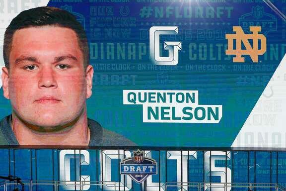 ARLINGTON, TX - APRIL 26:  A video board displays an image of Quenton Nelson of Notre Dame after he was picked #6 overall by the Indianapolis Colts during the first round of the 2018 NFL Draft at AT&T Stadium on April 26, 2018 in Arlington, Texas.  (Photo by Tim Warner/Getty Images)