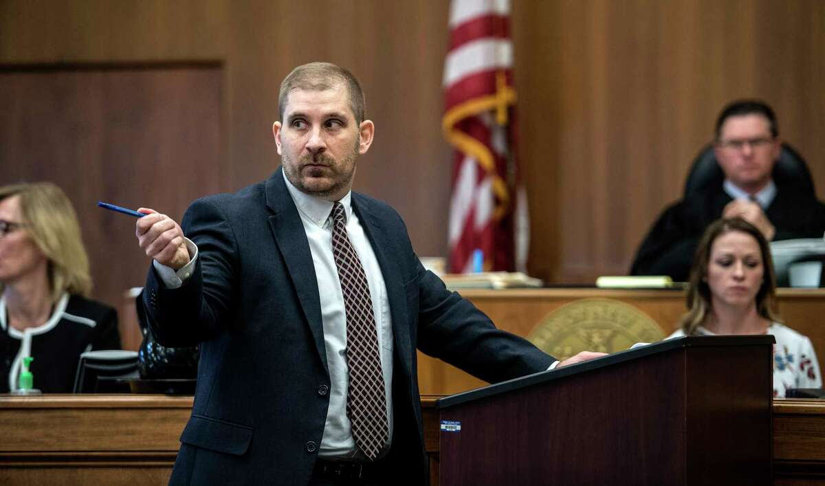 """Assistant District Attorney Peter Willis points at defendant Joevany """"Moon"""" Luna during his opening statements in the murder-for-hire trial in Schenectady County Courty Thursday April 26, 2018 in Schenectady, N.Y. (Skip Dickstein/Times Union)"""