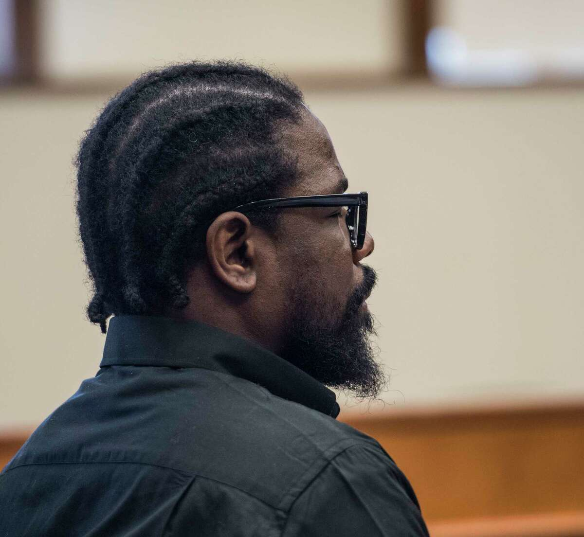 """Joevany """"Moon"""" Luna sits quietly during the opening statements in the murder-for-hire trial in Schenectady County Courty Thursday April 26, 2018 in Schenectady, N.Y. (Skip Dickstein/Times Union)"""