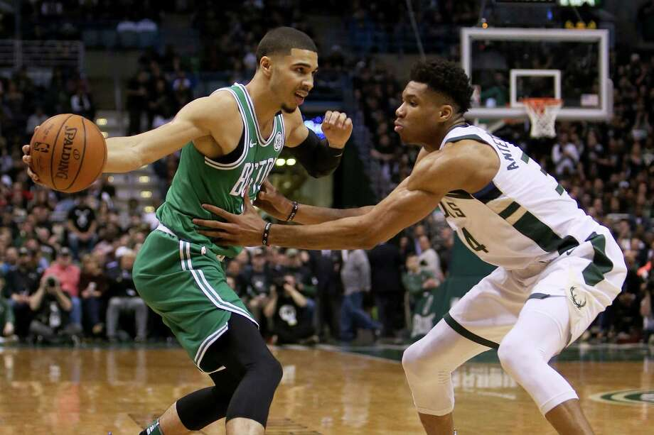 MILWAUKEE, WI - APRIL 26:  Jayson Tatum #0 of the Boston Celtics dribbles the ball while being guarded by Giannis Antetokounmpo #34 of the Milwaukee Bucks in the second quarter during Game Six of Round One of the 2018 NBA Playoffs at the Bradley Center on April 26, 2018 in Milwaukee, Wisconsin. NOTE TO USER: User expressly acknowledges and agrees that, by downloading and or using this photograph, User is consenting to the terms and conditions of the Getty Images License Agreement. (Photo by Dylan Buell/Getty Images) Photo: Dylan Buell / 2018 Getty Images