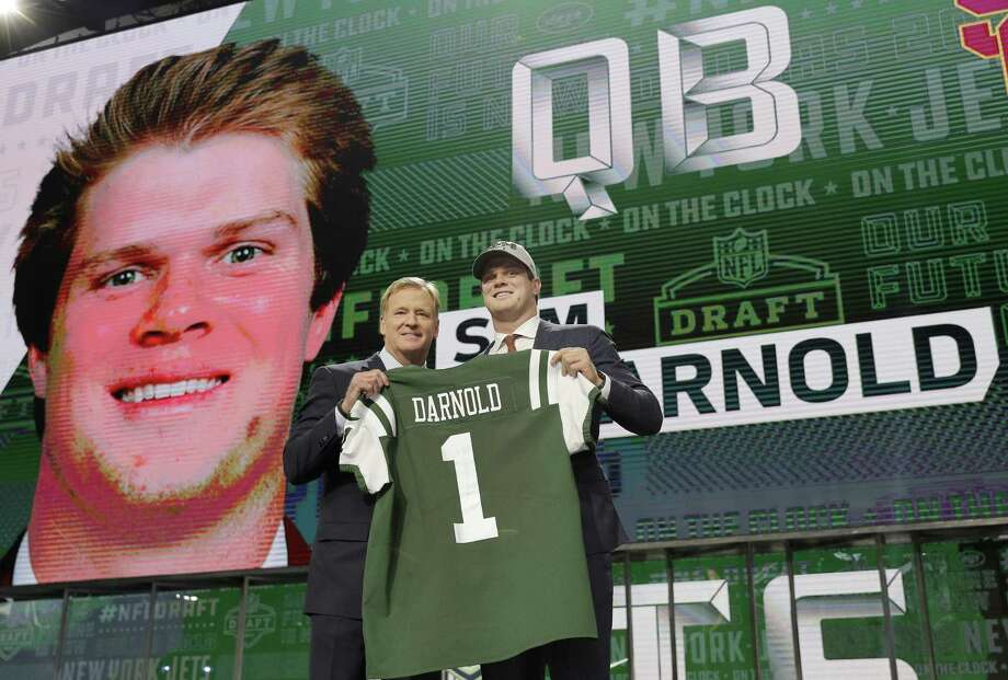 USC's Sam Darnold, right, poses with the commissioner after he became the second QB drafted, in the No. 3 spot by the Jets. Photo: David J. Phillip, STF / Associated Press / Associated Press