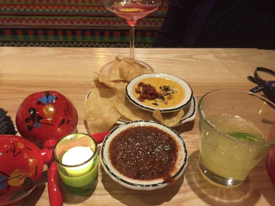 Salsa and margarita in foreground with queso and chips and a colorful cocktail behind it. Photo: Joe Amarante / Hearst Connecticut Media