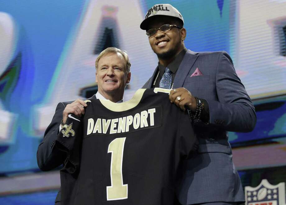 Commissioner Roger Goodell presents UTSA's Marcus Davenport with his New Orleans jersey during the first round in Arlington. Photo: David J. Phillip / Associated Press / Associated Press