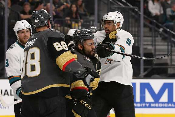 GLENDALE, NV - APRIL 26:  Evander Kane #9 of the San Jose Sharks corss-checks Pierre-Edouard Bellemare #41 of the Vegas Golden Knights in the third period Game One of the Western Conference Second Round during the 2018 NHL Stanley Cup Playoffs at T-Mobile Arena on April 26, 2018 in Las Vegas, Nevada. The Golden Knights defeated the Sharks 7-0.  (Photo by Christian Petersen/Getty Images)