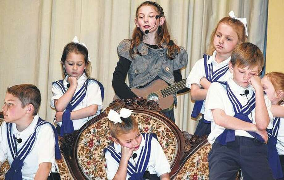 "Students from Salem Lutheran School perform Rodgers and Hammerstein's ""Getting to Know the Sound of Music"" on Thursday. Cast members include Noah Beckmann (from left) as Kurt, Phoebe Dean as Gretl, Lillie Brown as Louisa, Isabella Robinson as Maria Rainer, Hannah Beckmann as Marta, A.J. Gehrke as Friedrich and Leta Sheeley as Brigitta. The musical will be performed for the public at 7 p.m. today and 1 p.m. Saturday at Salem Lutheran Church and School, 222 E. Beecher Ave. Tickets are $10 for adults and $3 for children 12 and under."