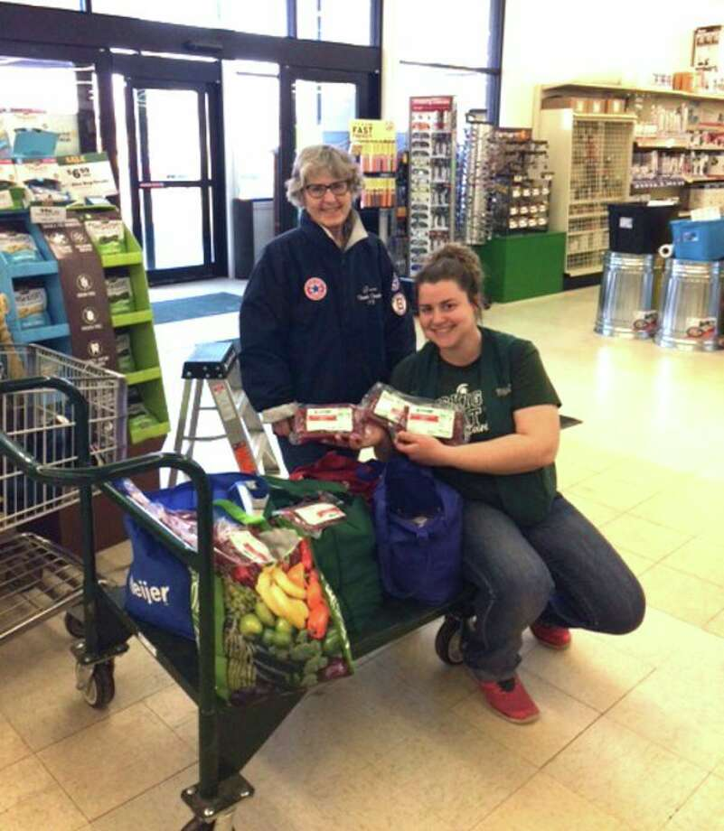 In March, Family Farm and Home in Bad Axe and its customers bought, and donated, licorice to the Thumb Chapter No. 178 Blue Star Mothers. The amount they donated will be enough to ship 20 boxes of licorice overseas. Pictured are (from left) Grace Rosenthal, Blue Star Mother and Leslie Marble, store manager of Family Farm and Home in Bad Axe. (Submitted photo)
