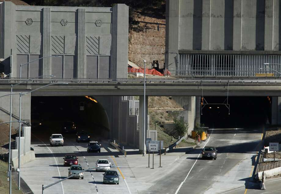 Westbound traffic flows out of the fourth bore of the Caldecott Tunnel (left) in Oakland, Calif., which opened for business on Saturday, Nov. 16, 2013. Photo: Paul Chinn / The Chronicle