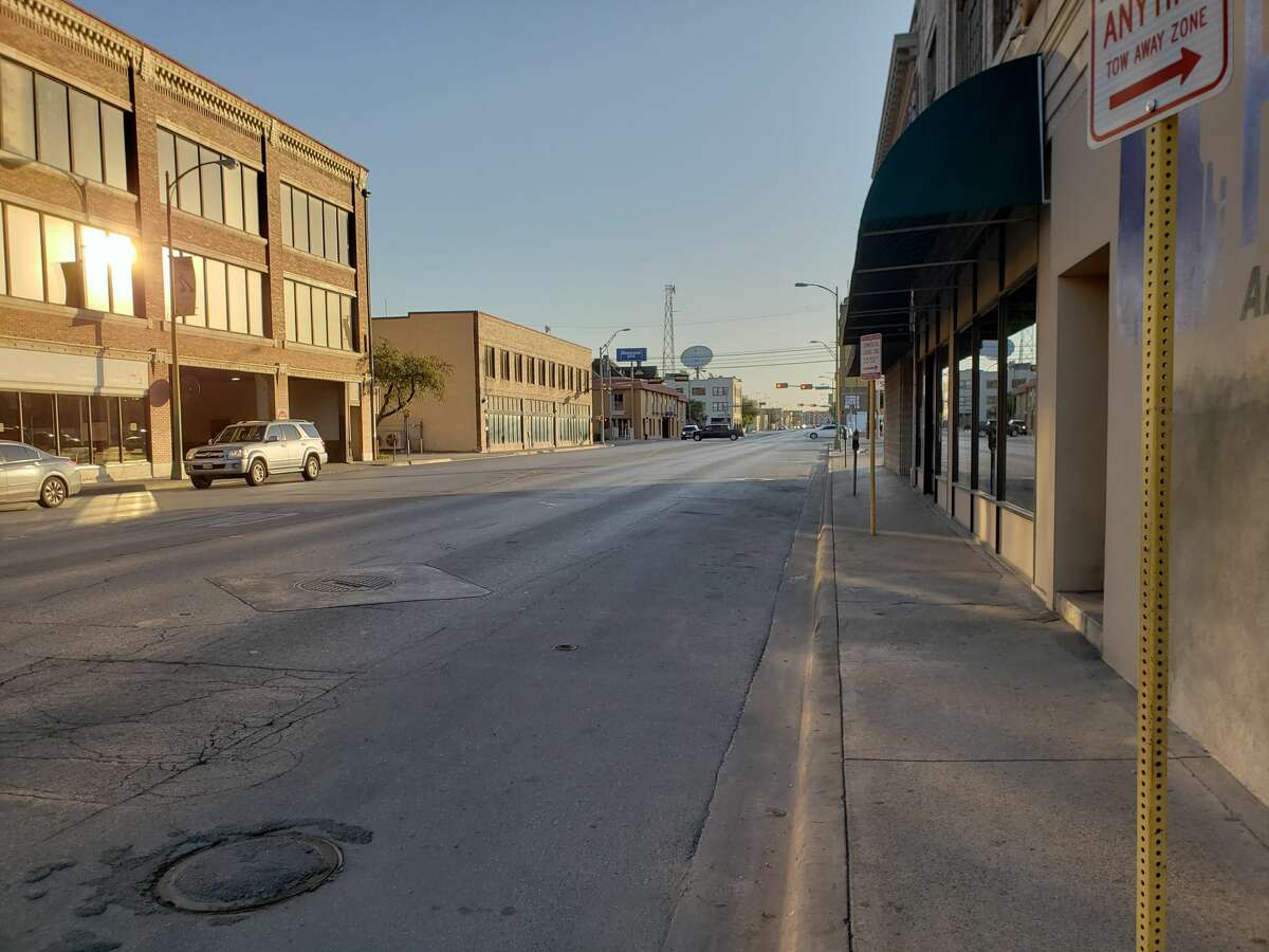 Before: Downtown streets are typically quiet during a regular work day, but are brought to life for the Battle of Flowers parade as thousands of locals take over the streets in the annual San Antonio tradition.