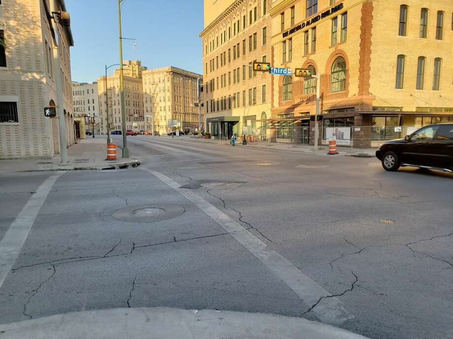 Before: Downtown streets are typically quiet during a regular work day, but are brought to life for the Battle of Flowers parade as thousands of locals take over the streets in the annual San Antonio tradition. Photo: Chris Eudaily/San Antonio Express-News