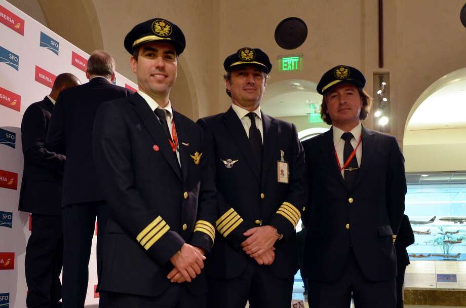 Iberia pilots pose at SFO event to celebrate arrival of the airline from Madrid this week Photo: Time Jue